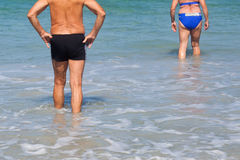 Retired couple walking in the sea Stock Photo