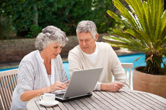 Retired couple working on their laptop Royalty Free Stock Photo