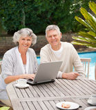 Retired couple working on their laptop Stock Image