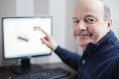 Retired develops computer technology at home Stock Photo