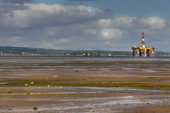 Retired drill platform in Comarty Firth, Scotland. Stock Photo
