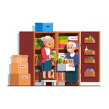 Retired family couple working at home pantry. Retired senior family couple people working together putting food preserves, pickle jars, bottles on home pantry or Royalty Free Stock Photo