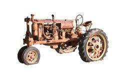 Retired Farm Tractor. This is a picture of a rusted, non-working antique farming tractor isolated on white Stock Photo