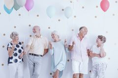 Retired friends at graduation anniversary stock photography
