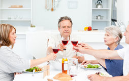 Retired friends toasting together Royalty Free Stock Image