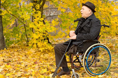 Retired handicapped man in an autumn park Royalty Free Stock Photos