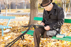 Retired handicapped man using a tablet Royalty Free Stock Images