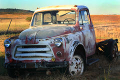 Retired International Harvester Pickup. An abandoned old International Harvester Pickup left retired in a golden field Royalty Free Stock Photos