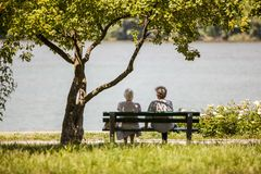 Retired ladies sitting on the bench enjoying Danube river royalty free stock photo