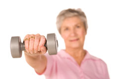 Retired lady lifting weights Royalty Free Stock Photo