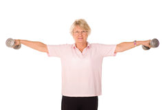 Retired lady lifting weights Stock Image