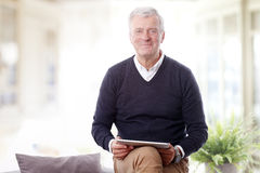 Retired man with digital tablet Royalty Free Stock Image
