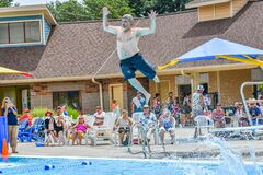 Retired Man Diving into Swimming Pool