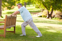 Retired man doing his stretches Stock Photos