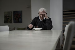 Retired man eating soup. Image of lonely retired man eating soup Stock Image