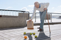 Retired man having dizzy on the open air Stock Photography