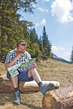 Retired man hiking in the alps Royalty Free Stock Photo