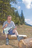Retired man hiking in the alps Stock Photos