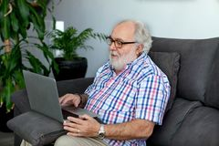 Retired man in his home Royalty Free Stock Image