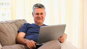 Retired man with his laptop stock footage