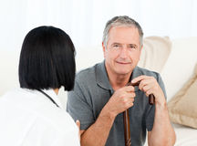 Retired man with his nurse Royalty Free Stock Photography