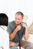 Retired man with his nurse Royalty Free Stock Photos