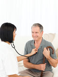 Retired man with his nurse Stock Photo
