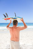 Retired man with his surfboard Stock Photography