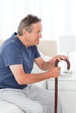 Retired man with his walking stick Stock Photos