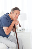 Retired man with his walking stick Stock Image
