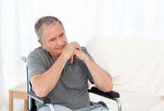Retired man in his wheelchair Stock Images