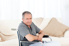 Retired man in his wheelchair Royalty Free Stock Photos