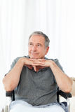 Retired man in his wheelchair Stock Photography