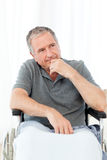 Retired man in his wheelchair Royalty Free Stock Photo