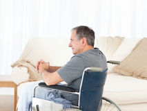 Retired man in his wheelchair Stock Photos