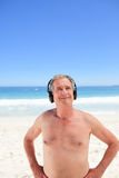 Retired man listening to some music Royalty Free Stock Photography