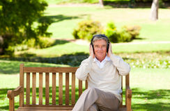 Retired man listening to some music Royalty Free Stock Photos