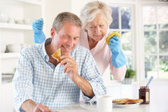 Retired Man Not Helping With Housework Royalty Free Stock Images