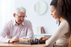 Retired man playing chess Royalty Free Stock Images