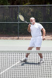 Retired Man Playing Tennis Royalty Free Stock Photo