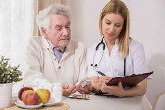 Retired man on private consultation. Photo of retired men on private medical consultation stock photos