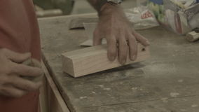 Retired Man 50s-60s working indoors in hobby shed or workshop with carpentry pow stock footage