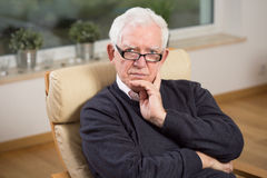 Retired man sitting on the chair Royalty Free Stock Photo