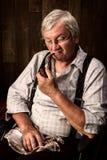 Retired man smoking pipe Royalty Free Stock Image