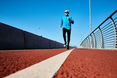 Healthy Retired Man Jogging Outdoors Stock Photography