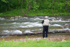 Retired Man Trout Fishing Royalty Free Stock Photos