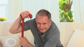 Retired man using a walking stick stock video footage