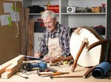 Retired man at work Stock Images
