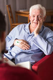 Retired man wtih carergiver Stock Photo