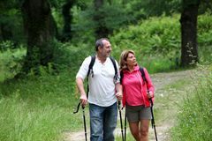 Retired people hiking on forest Royalty Free Stock Image